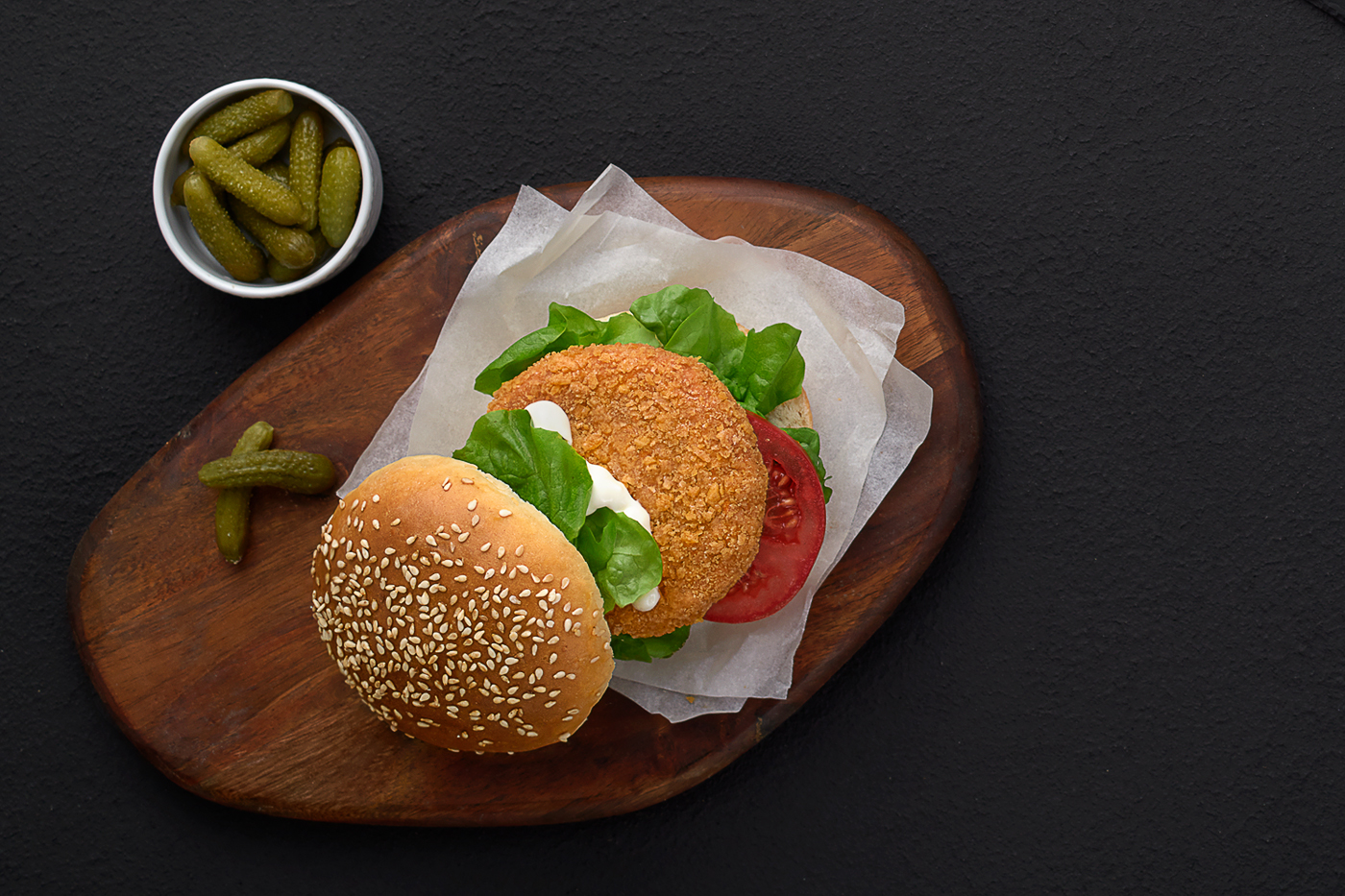 chicken Burger, tomatoes, ban, rocca and pickles
