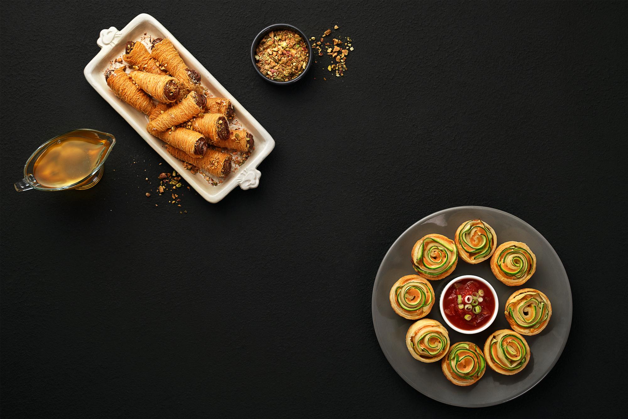 Konafa cones, chocolate, honey, nuts, puff pastry and red sauce